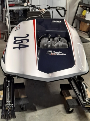 Bill Polson - 75 PDC 340. Built from a 80 TXL chassis. Hood and pan from AJ at Vintage Snowmobile Restoration. Custom seat by SCS in Duluth, MN. Decals and lettering TNT. Thank you all plus a lot of other people and suppliers.